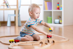 Child boy playing with toys indoors at home Royalty Free Stock Image