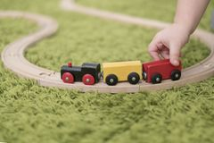 Small toddler in a colorful children room in a nursery or preschool. child boy playing with toys indicators at home Royalty Free Stock Photography