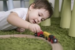 Small toddler in a colorful children room in a nursery or preschool. child boy playing with toys indicators at home Stock Photography