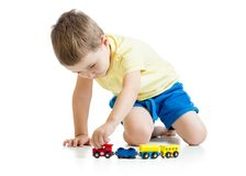 Child boy playing toys isolated n white background Royalty Free Stock Image