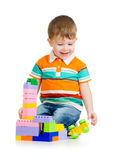Child boy playing with toys over white background Stock Image