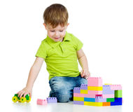 Child boy playing with toys over white background. Child boy playing with construction set over white background stock images