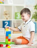 Child boy playing with wooden colorful cubes Stock Photography