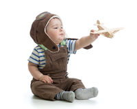 Child boy playing with wooden plane isolated on white Royalty Free Stock Photo
