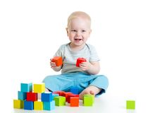 Child boy playing wooden toys Royalty Free Stock Photography