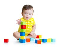 Child boy playing wooden toys Royalty Free Stock Images