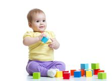 Child boy playing wooden toys Stock Photography