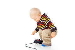 Child boy plays with a joystick Royalty Free Stock Photos
