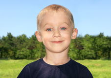 Child Boy Portrait cute. With forest on background royalty free stock images