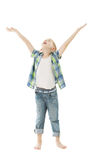 Child boy raise open hands up. Isolated white back. Ground. Open arms to put product here stock photo