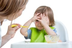 Child boy refuses to eat closing face by hands Stock Image