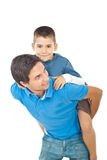 Child boy riding his father Royalty Free Stock Photos