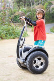 Child boy riding a segway on natural background Royalty Free Stock Photo