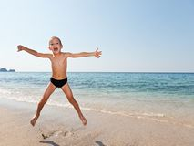 Child boy on sea beach Royalty Free Stock Photo