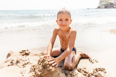 Child boy on sea beach Stock Photo