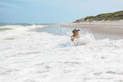 Child boy and sea wave splash Royalty Free Stock Image