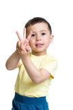 Child boy show the number three with hands. Kid boy show the number three with hands Stock Photo