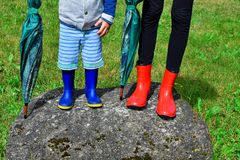 Child boy and sister wearing rubber boots stock photo