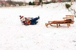 Child boy on a sled having fun Stock Images