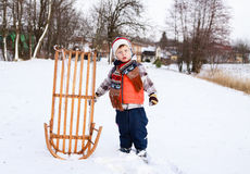 Child boy and sledge Royalty Free Stock Images