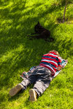 Child boy sleeping in grass Stock Photos