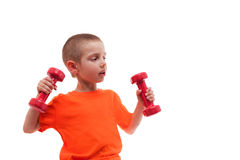 Child boy sport exercising raise dumbbells isolated Royalty Free Stock Image