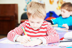 Child boy studying writing. Cute little boy studying writing at the classroom Stock Photography