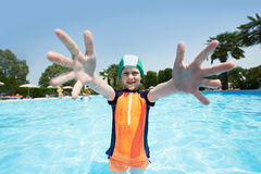 Child Boy in swimming pool stock images