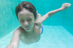 Child boy swimming underwater Stock Images