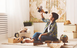 Child boy teenager dreams of becoming pilot and  aviator traveli Stock Image