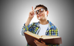 Child boy teenager with glasses and book. Funny child boy teenager with glasses and book Royalty Free Stock Photos