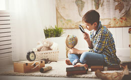 Child boy teenager studying  map of world, globe, geography, dre Stock Photos
