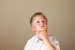 Child (boy) thinking Stock Images