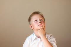Child (boy) thinking Stock Images