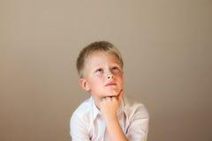 Child (boy) thinking Stock Image
