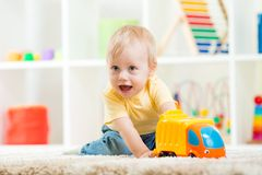 Child boy toddler playing with toy car Stock Images