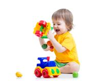 Child boy toddler playing toy isolated Royalty Free Stock Image