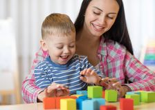 Child boy together with mother playing toys Royalty Free Stock Photo