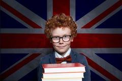 Child boy on the UK flag background.  stock photos