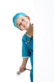 Child boy uniformed as doctor behind banner Stock Image