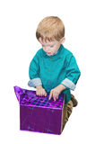 Child boy unwraps the gift Stock Photography