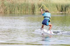 Child boy wake boarding Royalty Free Stock Image