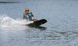 Child boy wake boarding Royalty Free Stock Photo