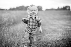 child boy walking in a meadow Royalty Free Stock Images