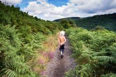 Child walking on nature path, Dartmoor, England stock photo