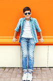 Child boy wearing a sunglasses and shirt in city Stock Photos