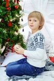 Child boy in a winter sweater. The concept of Christmas and New. Year stock image