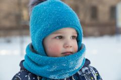 Portrait of boy in winter outdoors Stock Images