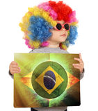 Child with Brazilian soccer background. Little child with clown wig support Brazilian team vector illustration