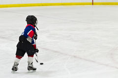 Child on a breakaway during ice hockey game Stock Image